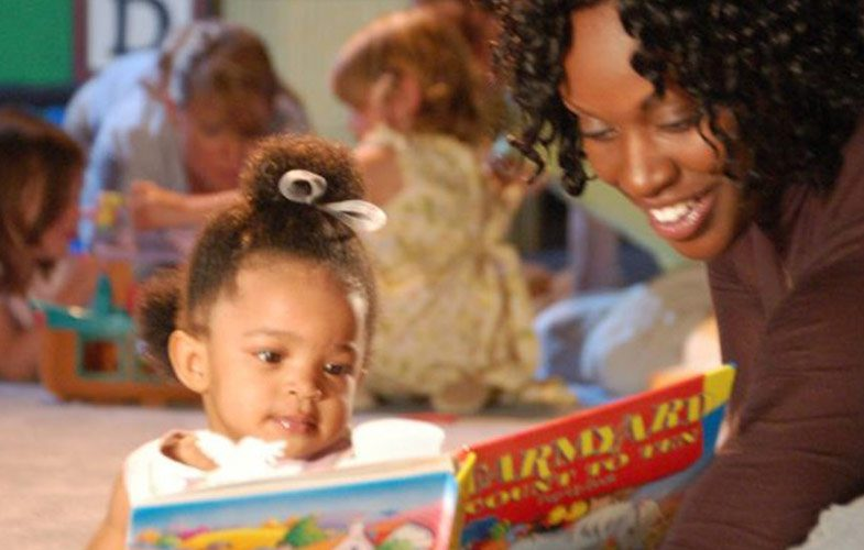 woman reading to small child