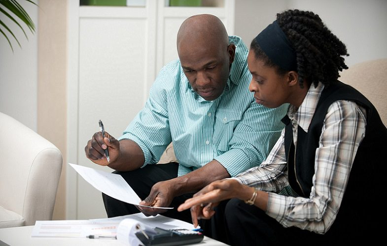 man and woman working through their finances