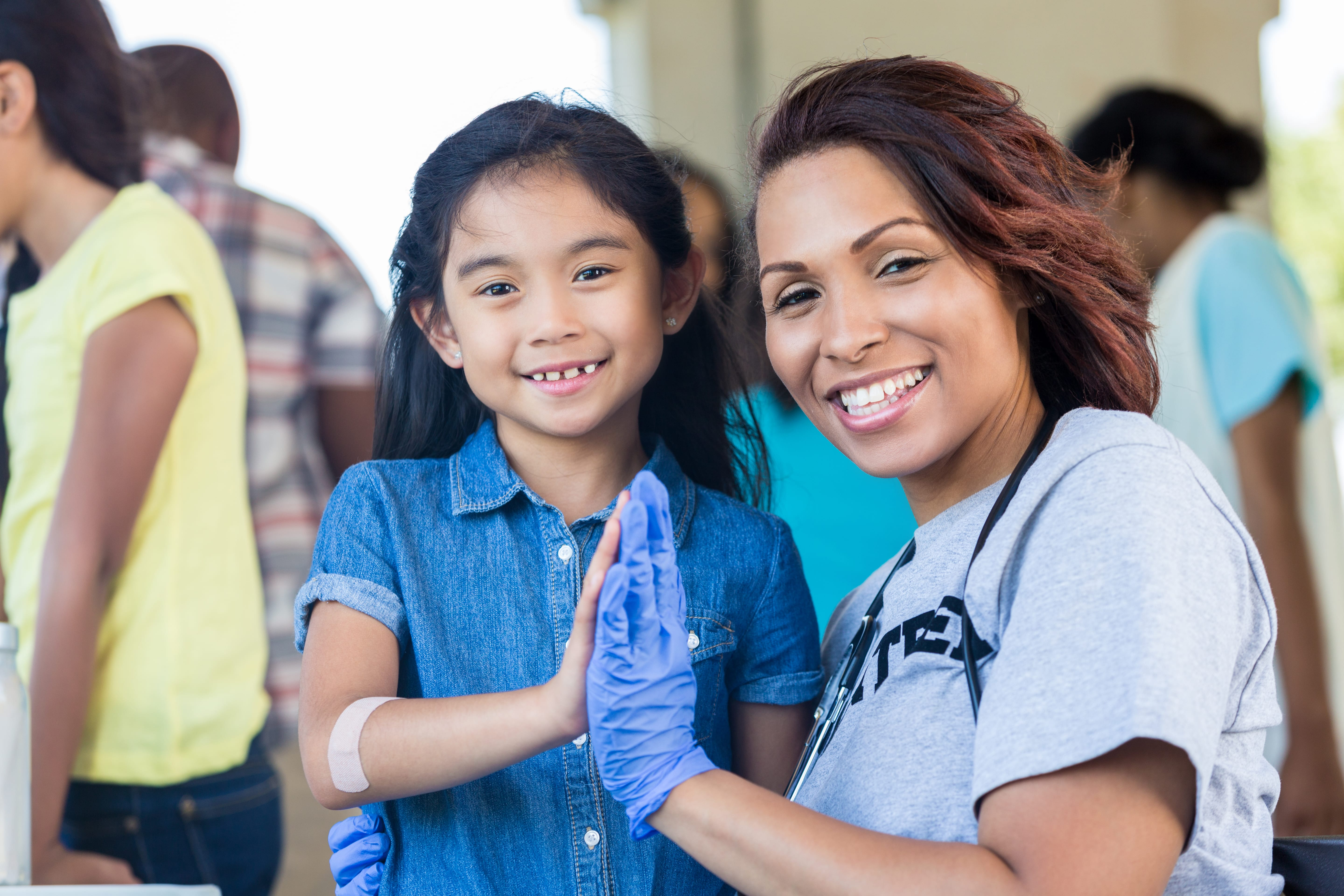 woman and young girl high fiving
