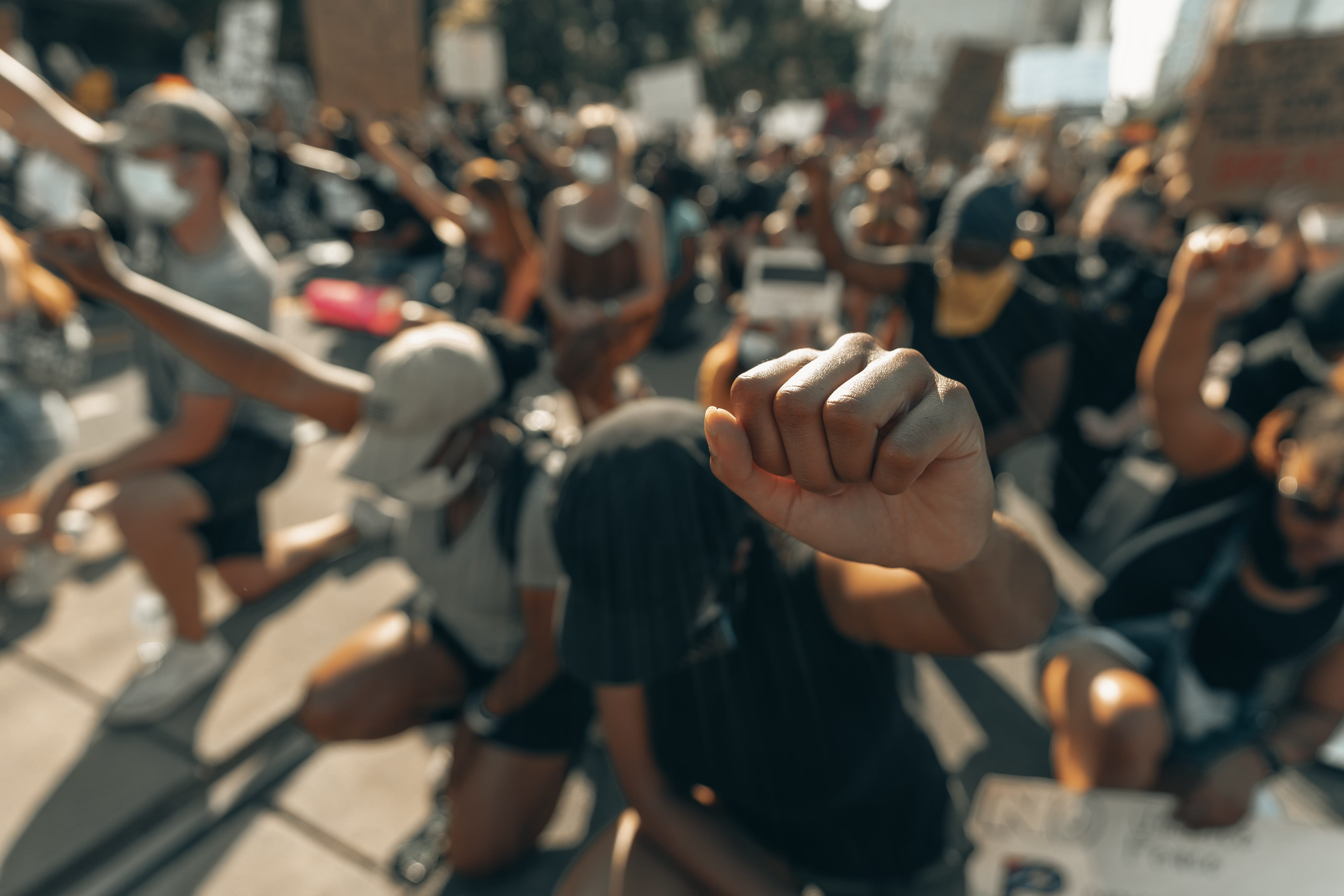 black women with fists raised